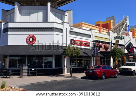 GLENDALE, AZ, USA - FEB 25, 2016:  Chipotle Mexican Grill, a fast food chain with locations in multiple countries and Just Sports store at the Westgate Entertainment District. - stock photo