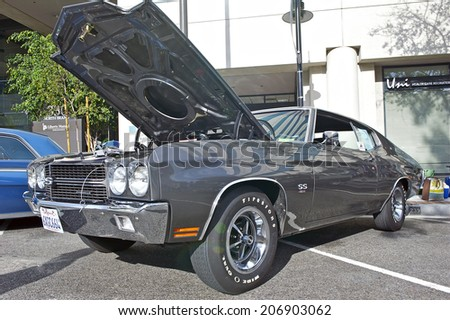 GLENDALE/CALIFORNIA - JULY 19, 2014: 1970 Chevy Chevelle owned by Jim Divechio at the Glendale Cruise Nights Car Show July 19, 2014 Glendale, California USA - stock photo