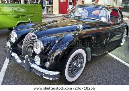 GLENDALE/CALIFORNIA - JULY 19, 2014: 1958 Jaguar XK150 owned by Rafi Kureghian at the Glendale Cruise Nights Car Show July 19, 2014 Glendale, California USA  - stock photo
