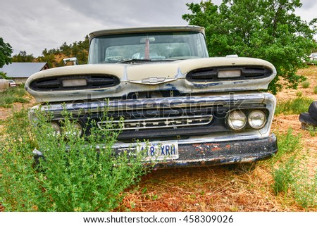 Glendale, Utah - July 1, 2016: Rusting old car in a desert junk yard.