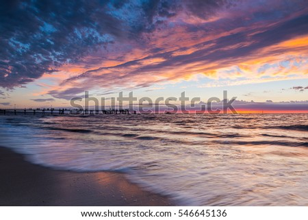 Glenelg Beach is a popular destination for both visitors to and residents of Adelaide, South Australia alike, particularly to watch the sunset.