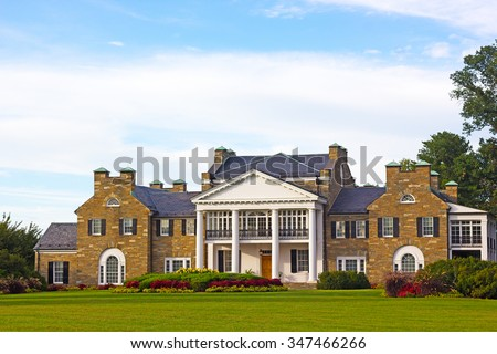 Glenview historic mansion with formal gardens at sunset. Historic Mansion at Civic Center Park in Rockville, Maryland, USA - stock photo