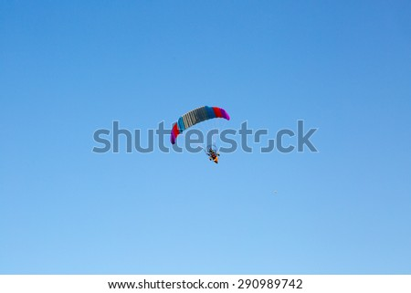 glider flying in the blue sky - stock photo