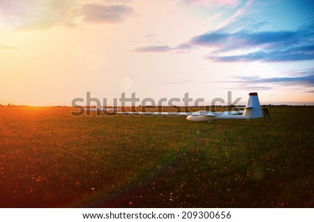 Glider ready for take off at sunset - sailplane sport & aviation photo - stock photo