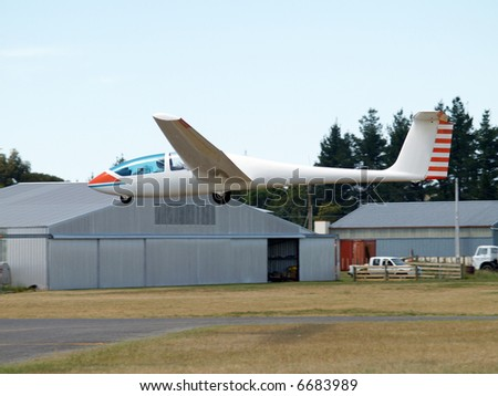 Glider (Type G103 Twin II) coming in to land - stock photo