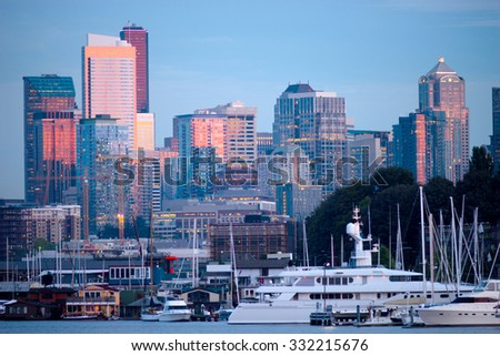Glimmering new buildings line the contemporary Seattle Skyline - stock photo