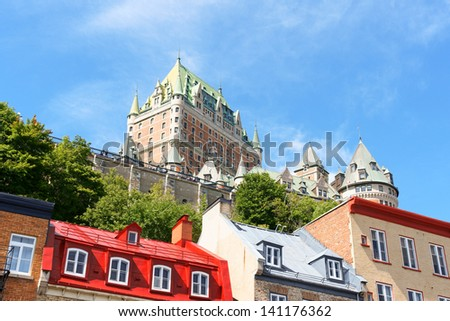 Glimpse of Quebec City. View of some old buildings from the lower old town and Chateau Frontenac Hotel in the background. - stock photo