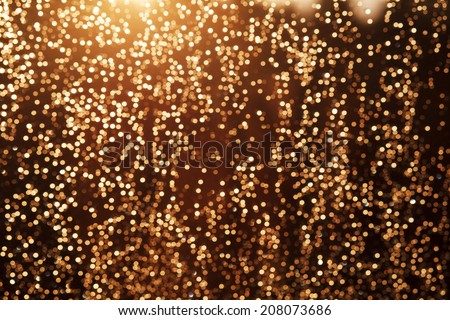 Glitter festive christmas lights background. light and gold de focused texture - stock photo