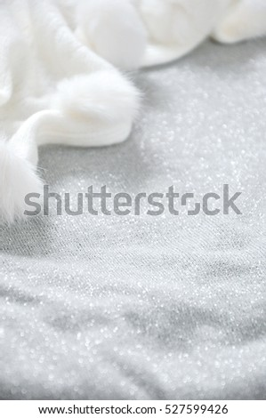 Glitter grey background with white puffy scarf