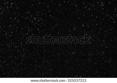 glitter lights background. light silver, blue and black. defocused.  - stock photo