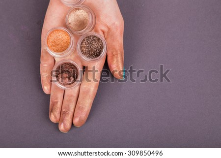 Glitter makeup and flouring. The concept of beauty and makeup - stock photo