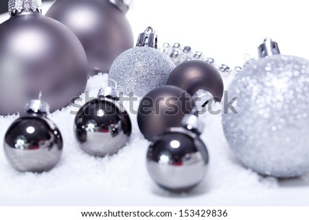 glitter silver christmas baubles decoration holidays isolated on white - stock photo