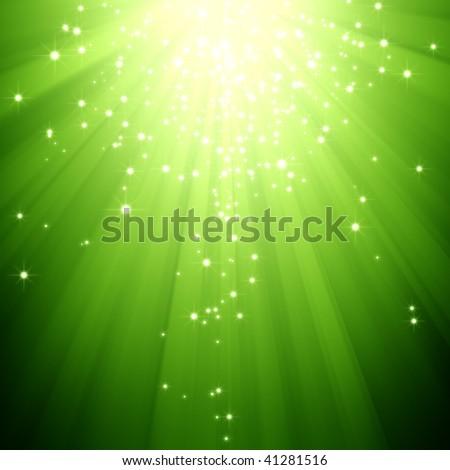 glitter stars descending on green light burst - stock photo
