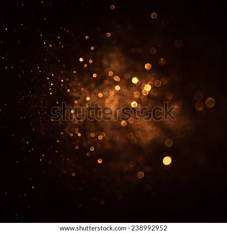 glitter vintage lights background. dark gold and black. defocused  - stock photo