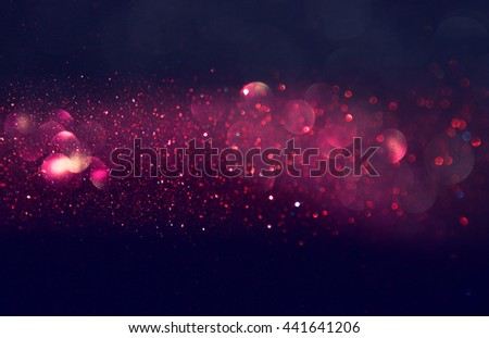 glitter vintage lights background. pink, black and purple. defocused