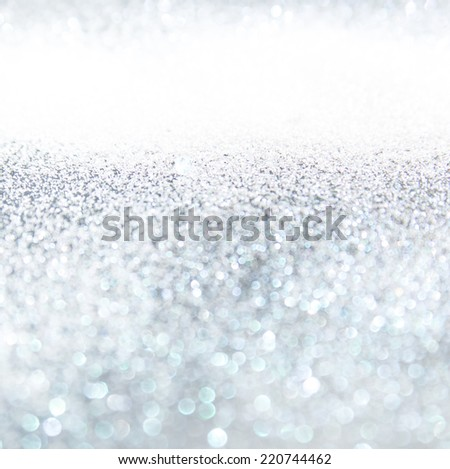Glitter vintage lights background, the silver and black. Image defocused. - stock photo