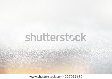 Glitter vintage lights background, the silver and blue. Image defocused. - stock photo