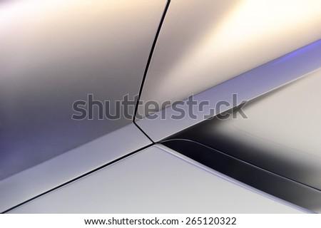Glittered surface of powerful sport car titanium aerodynamic bodywork with fragment of air intake - stock photo