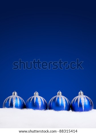 Glittering blue Christmas balls on dark  background. Copy space for your text. - stock photo