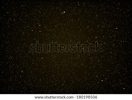 Glittering gold background. Twinkling glitter background. - stock photo