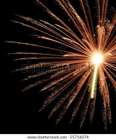 Glittery burst of reddish-orange fireworks with big white-hot core and rocket trail, off center - stock photo