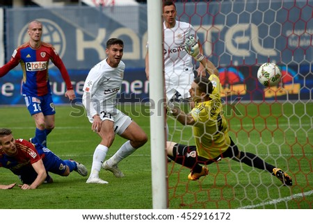 GLIWICE, POLAND - MAY 15, 2016: Match Polish Premer League between KGHM Zaglebie Lubin - Piast Gliwice. Michal Papadopulos shotting goal.