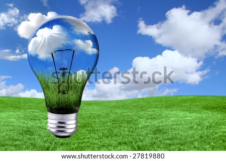 Global Concept of Green Energy Solutions With Light bulb and Planet on Bright Landscape - stock photo