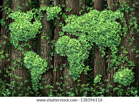 Global development and the green economy as a business concept with a map of the world made of an organized group vine leaves growing on forest trees as an environmental conservation symbol. - stock photo