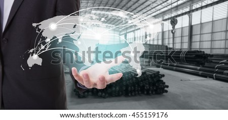 Global network coverage world map on hand of businessman ,Industrial steel pipes for Logistic Import Export background (Elements of this image furnished by NASA)