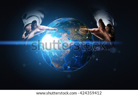 Global networking system with businessman hands over illuminated globe with network on dark blue background. Elements of this image furnished by NASA