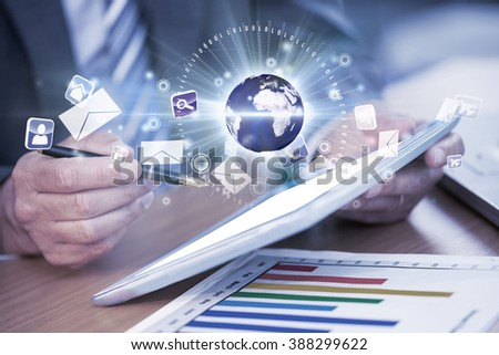 Global technology background against businessman working on his digital tablet - stock photo