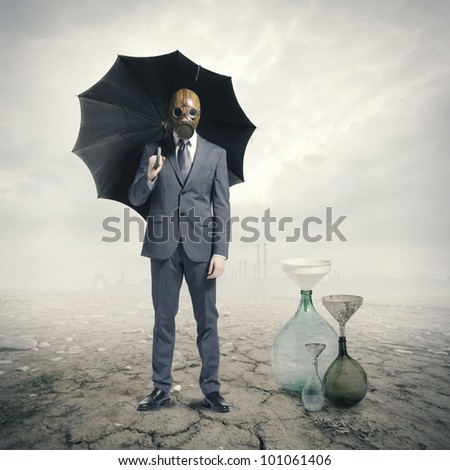 Global Warming:Businessman waiting for the rain - stock photo