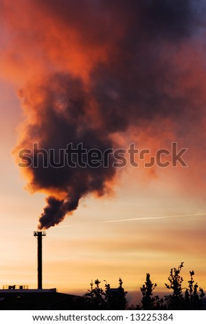 Global warming concept: smoke coming out of chimney - stock photo