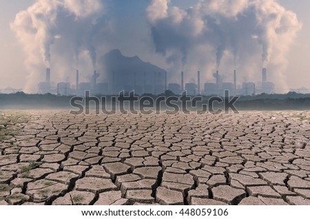 Global warming, Dry cracked earth with Pollution Coal power plant. - stock photo