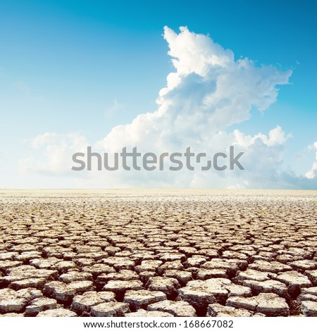 global warming. hot weather in desert under clouds - stock photo