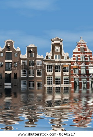 Global warming: Houses in Amsterdam, overflow of water (flood) - stock photo