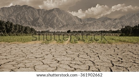 Global warming is a real threat for our civilization. Conceptual composite image symbolizing a drastic change in climate of our planet  - stock photo