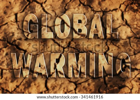 Global warming text on dry soil - stock photo