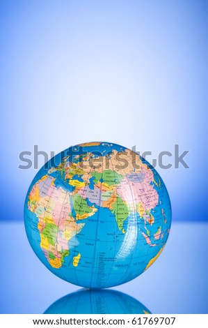 Globalisation concept - globe against gradient colorful background - stock photo