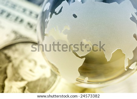 Globe and american dollars. Global finances concept - stock photo