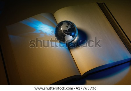 globe and book, business and education concept