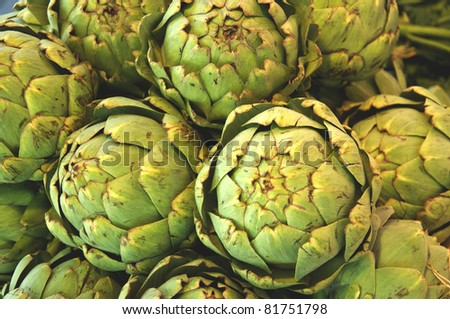 Globe artichokes on a market in Italy, where it is a popular vegetable - stock photo