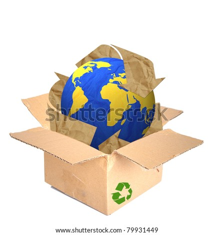 Globe create by recycled paper craft stick in a recycle shipping box . - stock photo