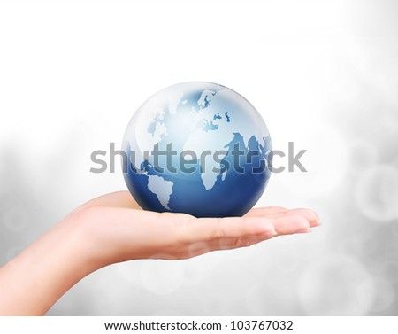 Globe ,earth in human hand against - stock photo