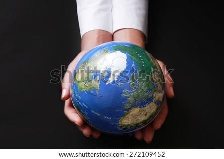Globe, Global Communications, Human Hand. - stock photo