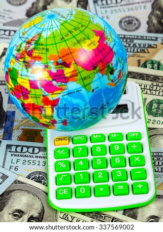 globe in calculate on US dollar bill concept background, economy concept - stock photo