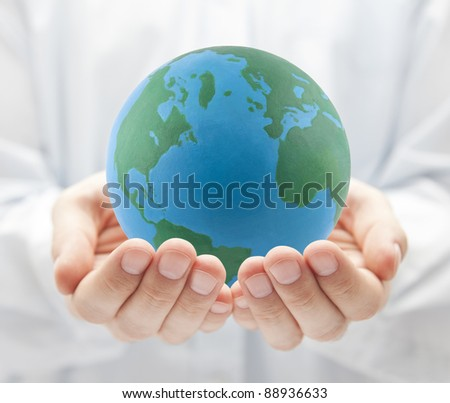 Globe in hands - stock photo