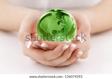 Globe in womans hands concept for protecting the earth and environmental conservation - stock photo