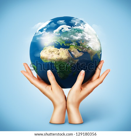 Globe in women's hands. Elements of this image furnished by NASA - stock photo