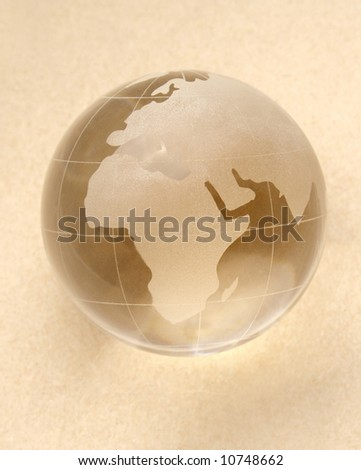 globe isolated on beige background with reflection - stock photo